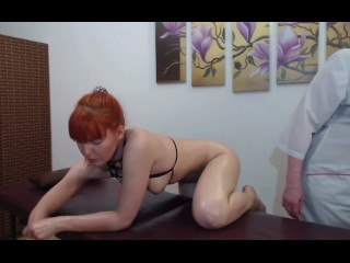 Redhead lesbian squirt on massage table