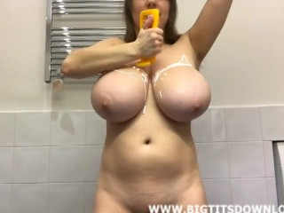 Brunette with giant tits and green bikini